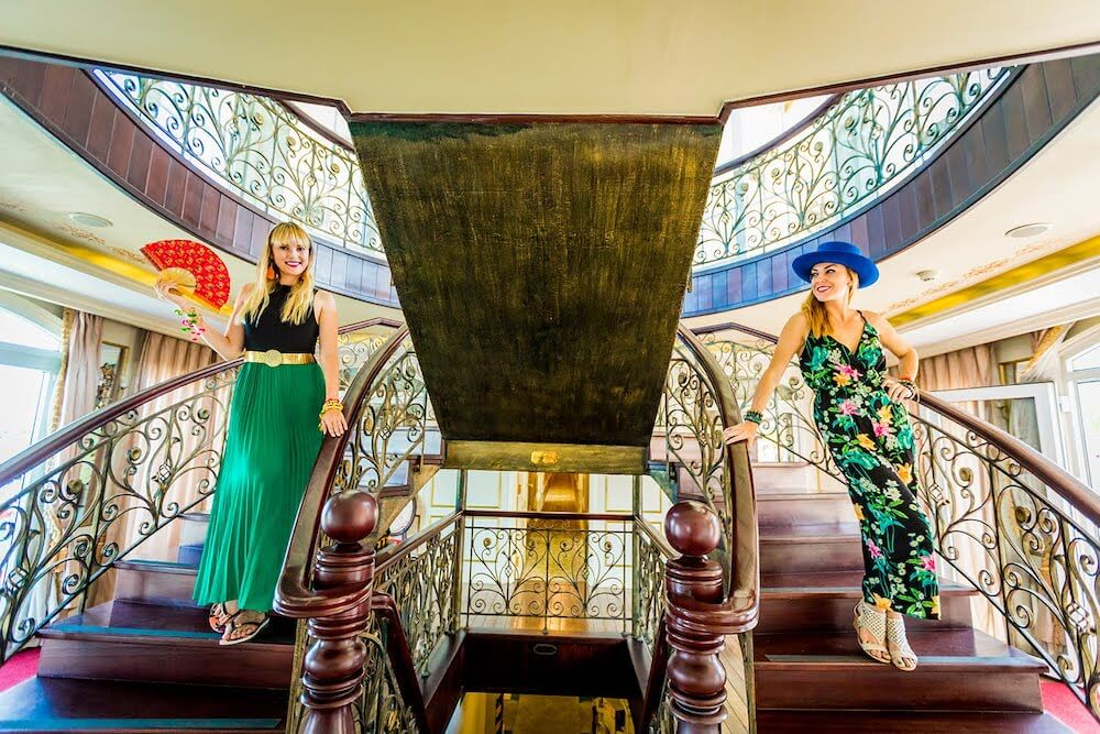 "Laura and I having our ""Titanic"" moment on the beautiful staircase onboard!"