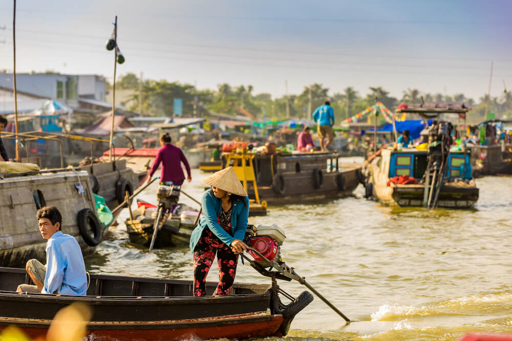 Enjoy life and tasting local fruits from the Floating Market in Vietnam.