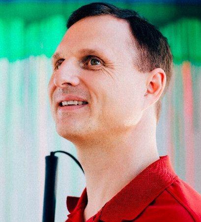 Photo of Matt King wearing a red shirt