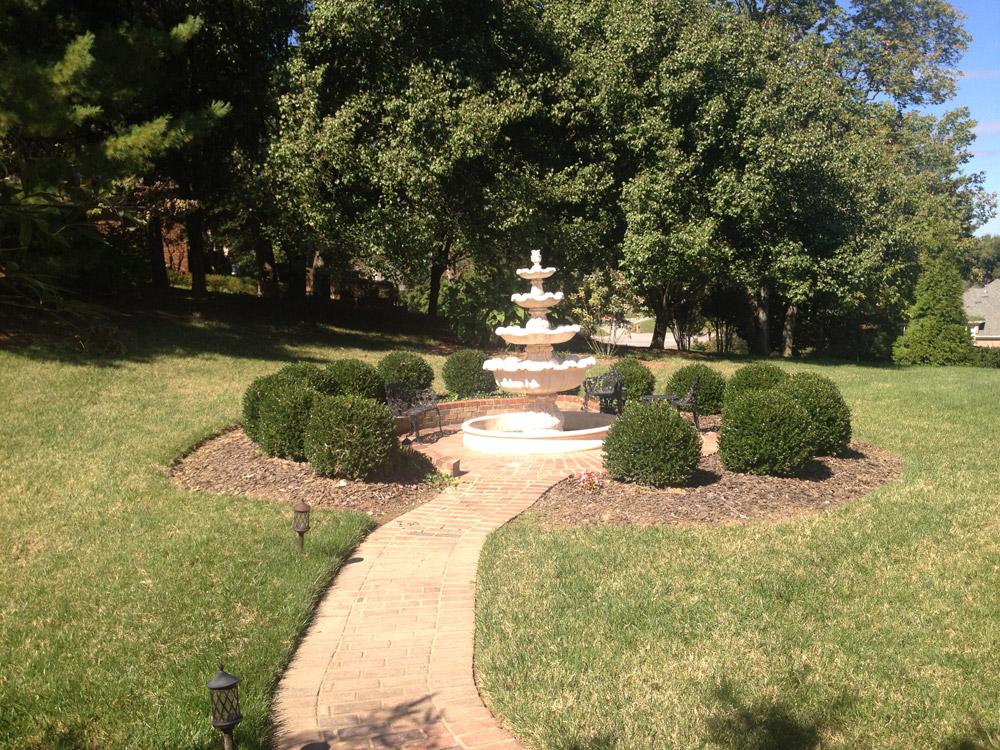 Brick pathway surrounding fountain
