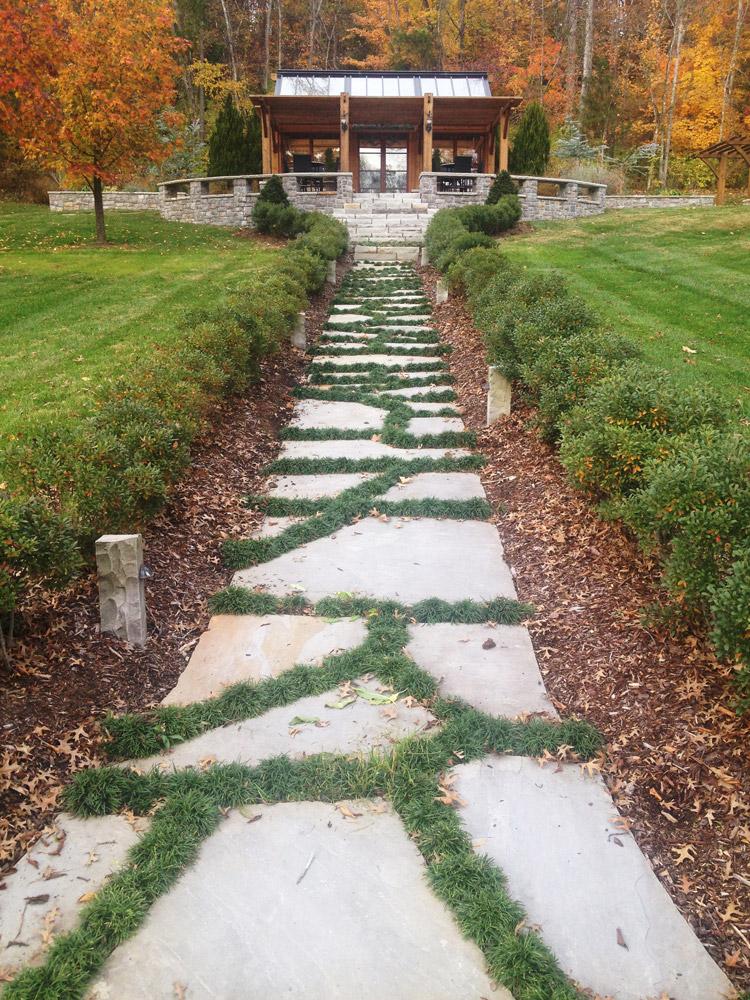 Stone walkway planted with Dwarf Mondo Grasses