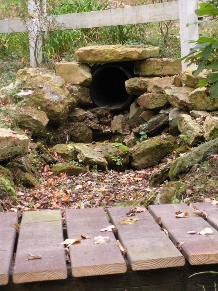 Installed stone to hide drainage culvert
