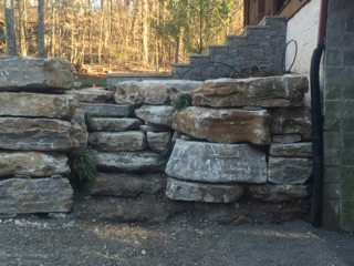Natural stone used to construct retaining wall, stairwell and steps