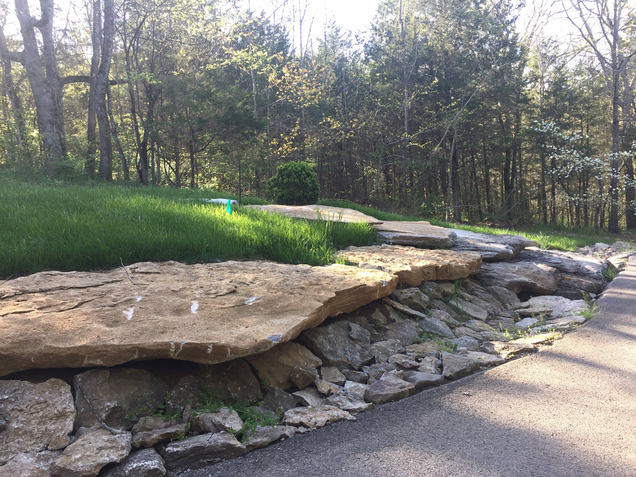 Natural stones used to construct drainage ditch
