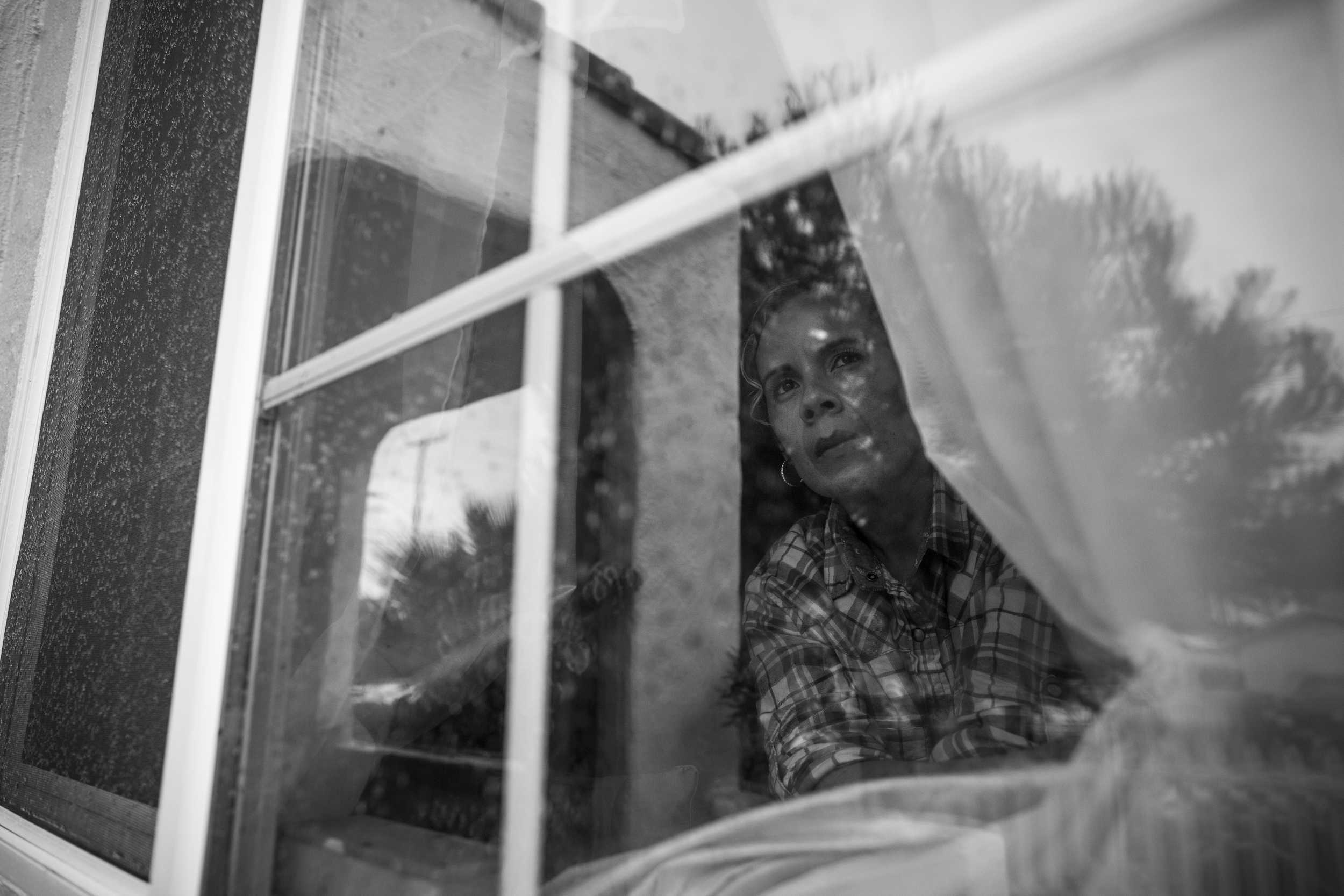 """""""People can make you feel like a slave,"""" says Maria as she watches the cars drive down her street in Ventura, California."""