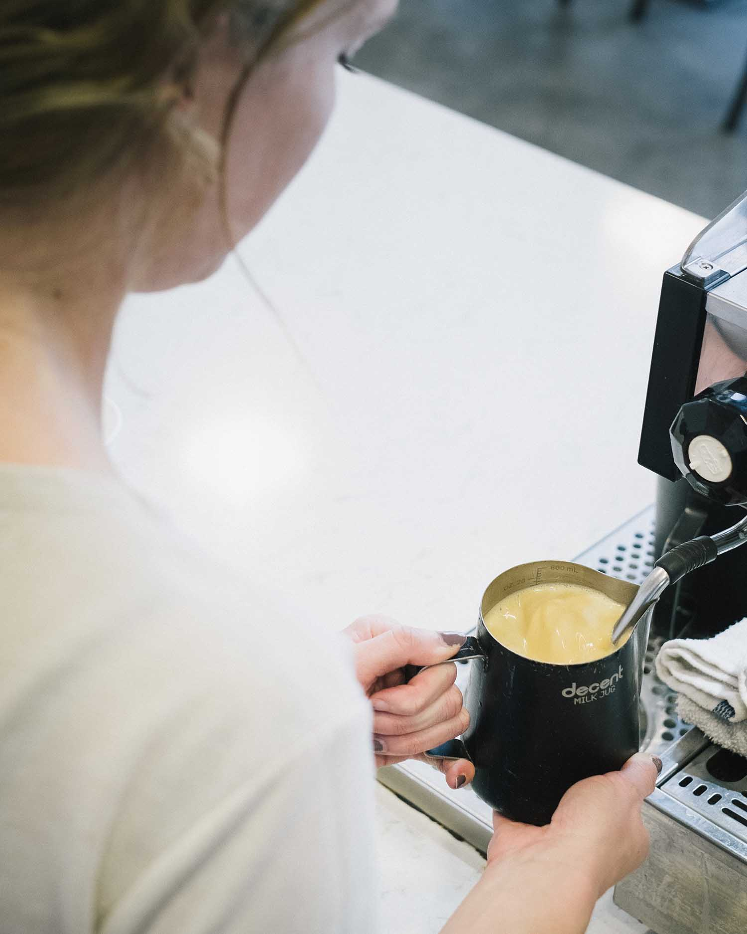 Girl making a specialty coffee.jpg