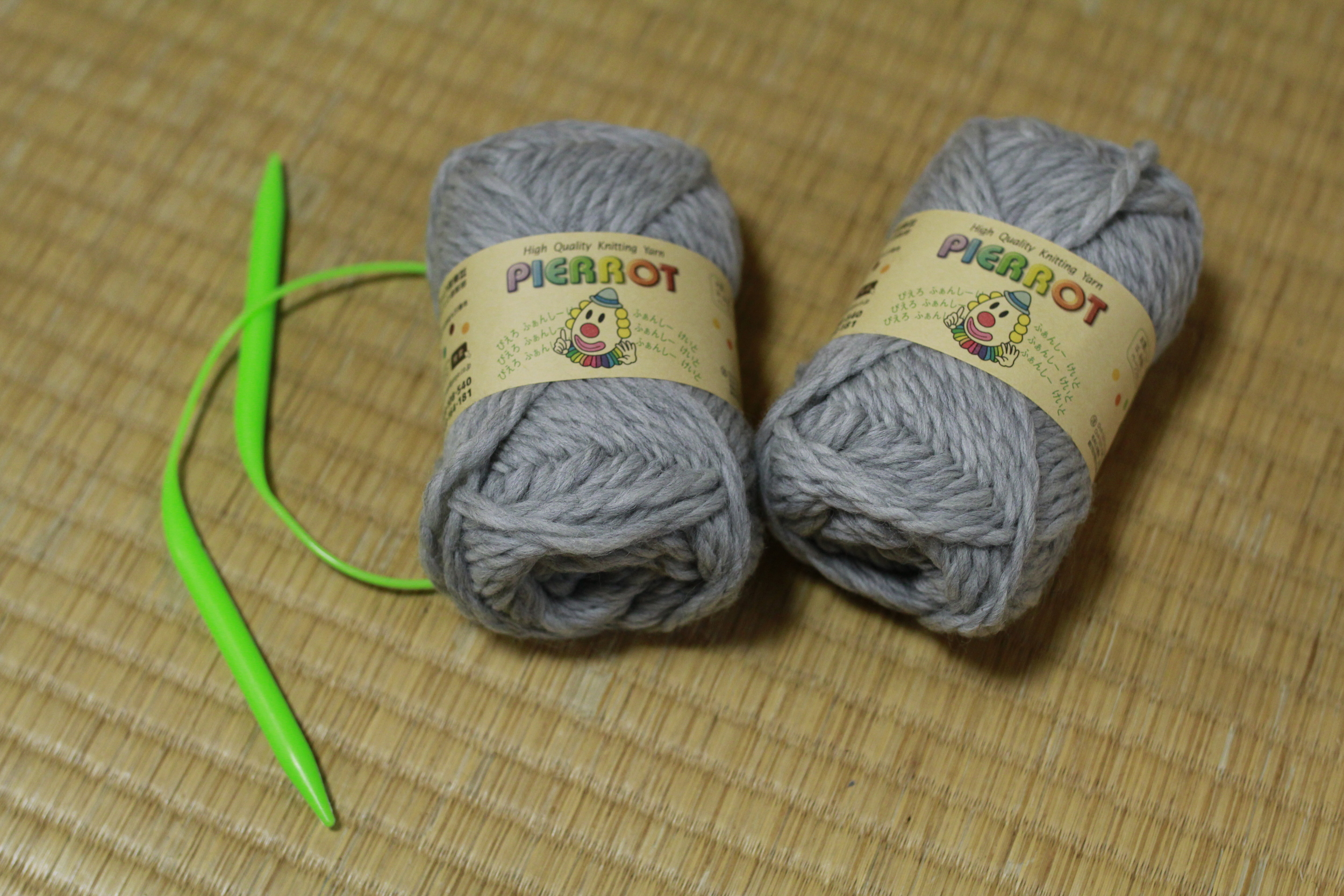 "Two balls of super chunky yarn and a pair of size 11, 19"" knitting needles."