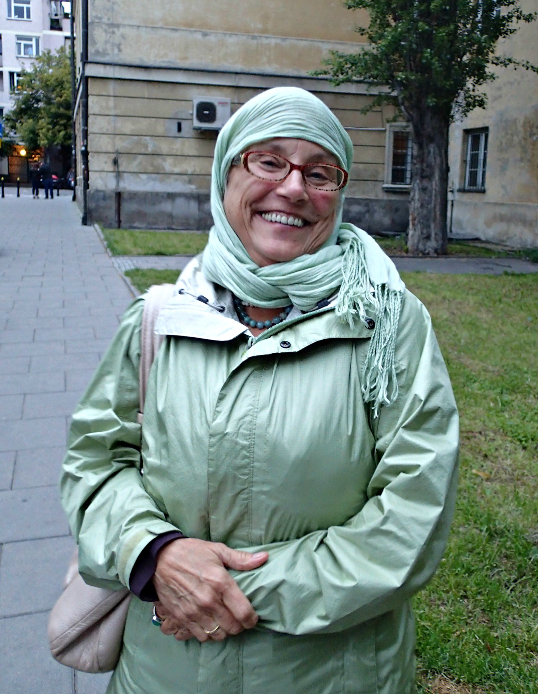 As we walked down the street en masse, it began to drizzle so Patty wrapped her scarf around her head. When I told her she now looked Muslim, she began to laugh and I captured this pic at just the right moment.