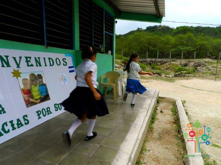 Girls Playing Around the Main Building