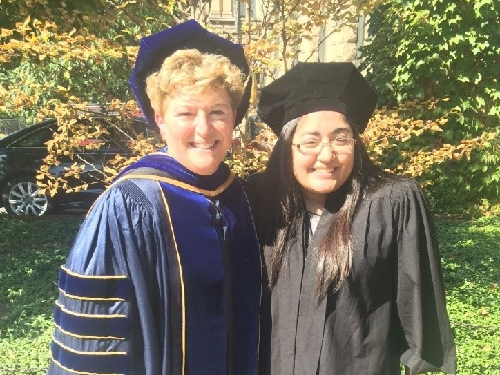 Nancy poses with Dean of Cornell's College of Agriculture and Life Sciences, Kathryn Boor (left). This photo was taken at President Garrett's inauguration ceremony on ­­September 18th, 2015 where Nancy was privileged to walk and carry the symbol for CALS.