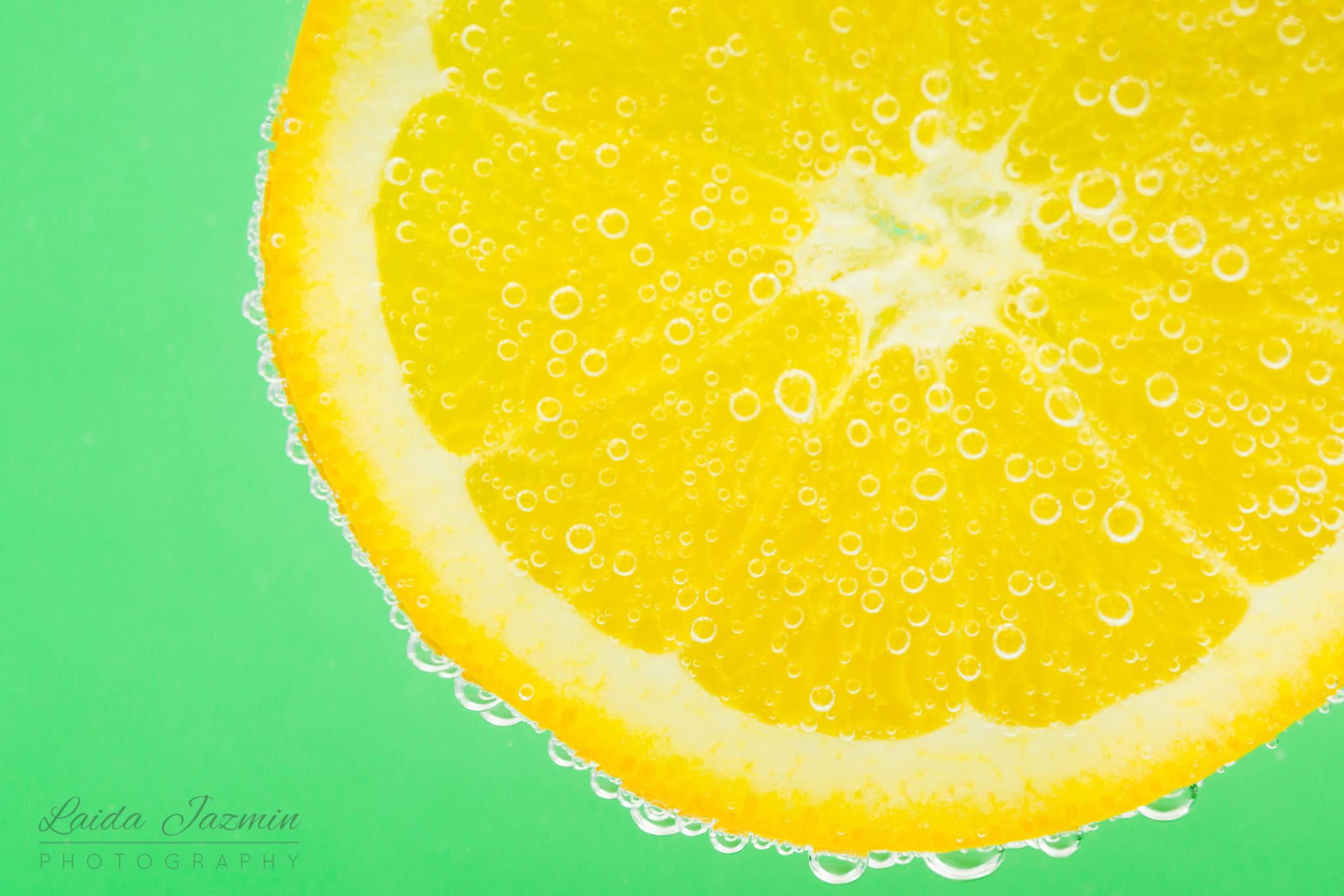 Fizzy. vibrant orange slice!