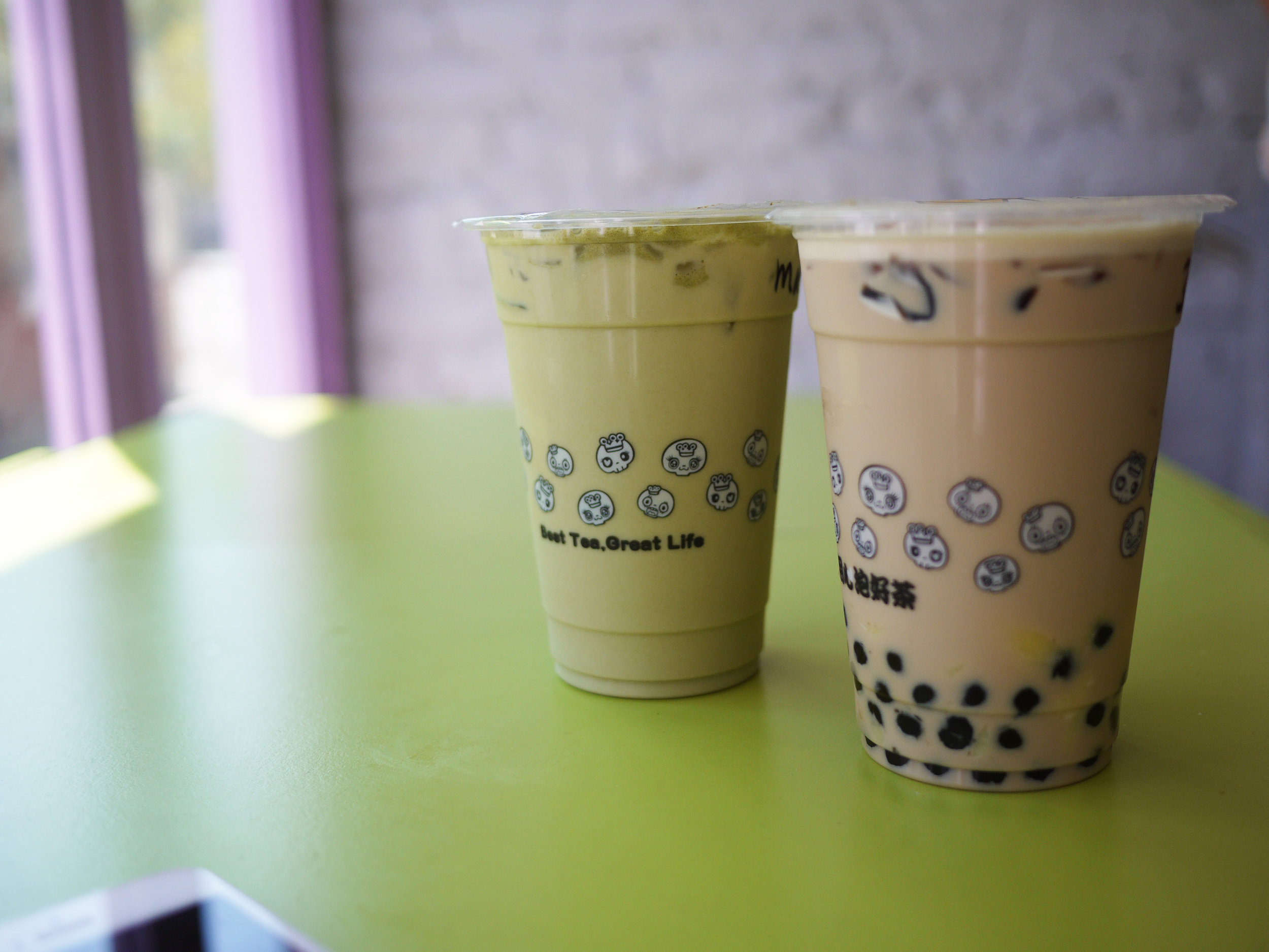 japanese matcha milk tea + lychee jelly and yellow moo milk (milk tea + grass jelly + egg pudding)