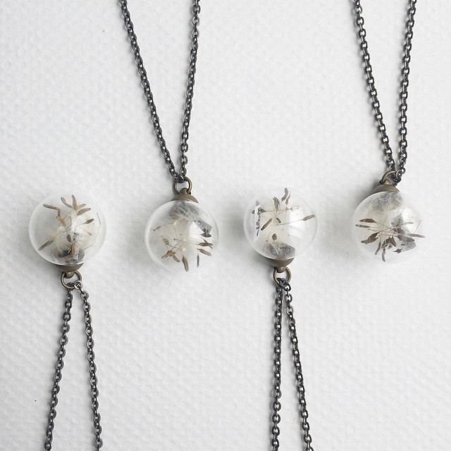 Just made some Make a Wish / Dandelion fluff glass sphere necklaces. I picked the dandelion seeds last weekend at Hoyt Arboretum, here in Portland.