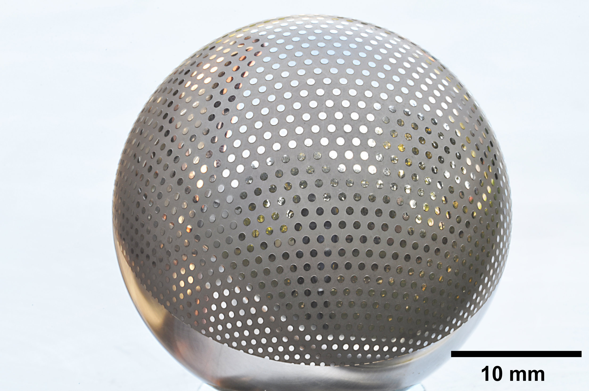 A 30 mm diameter steel sphere machined to a depth of 20 μm, leaving a pattern of unmachined disks.