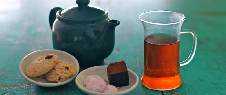 Tea_in_different_grade_of_fermentation.jpg
