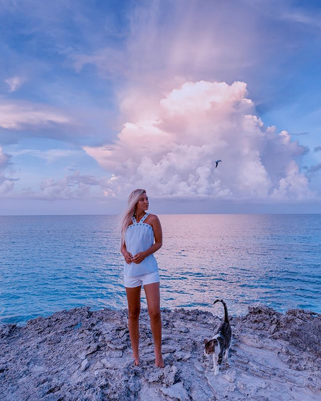 """""""Clouds come floating into my life, no longer to carry rain or usher storm, but to add color to my sunset sky."""" -Rabindranath Tagore . . . How cute is my cat watching the sunset with me? 🐈  Whoever guesses his name goes on my story! ✨ 💫 Outfit by @southerntide 💙"""