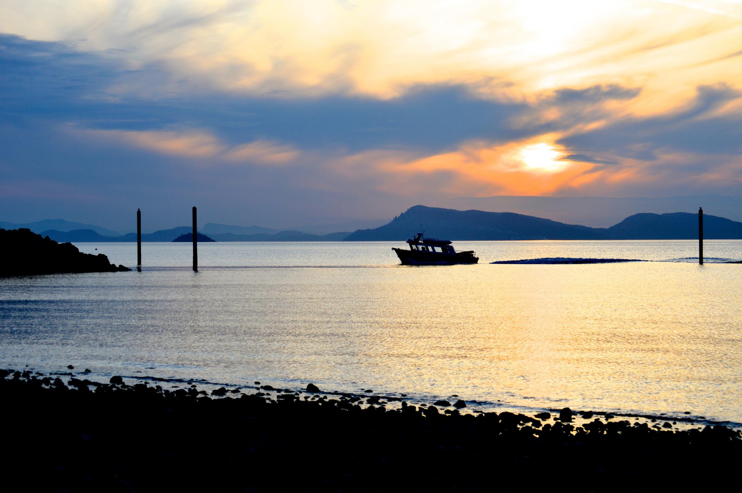 Boat returning at Sunset on Orcas Island