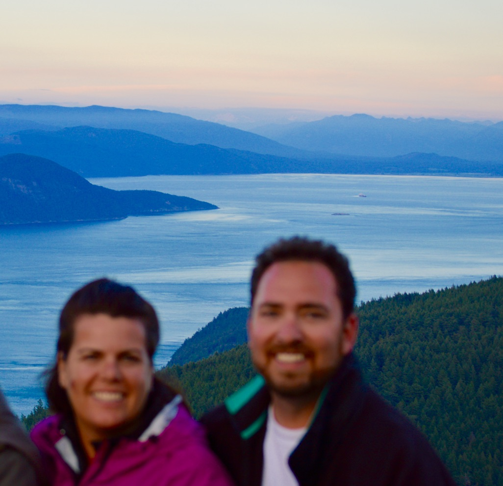 At the top of Mt. Constitution in Moran State Park. Yes, we're blurry on purpose - the focus belongs on the beauty behind us!