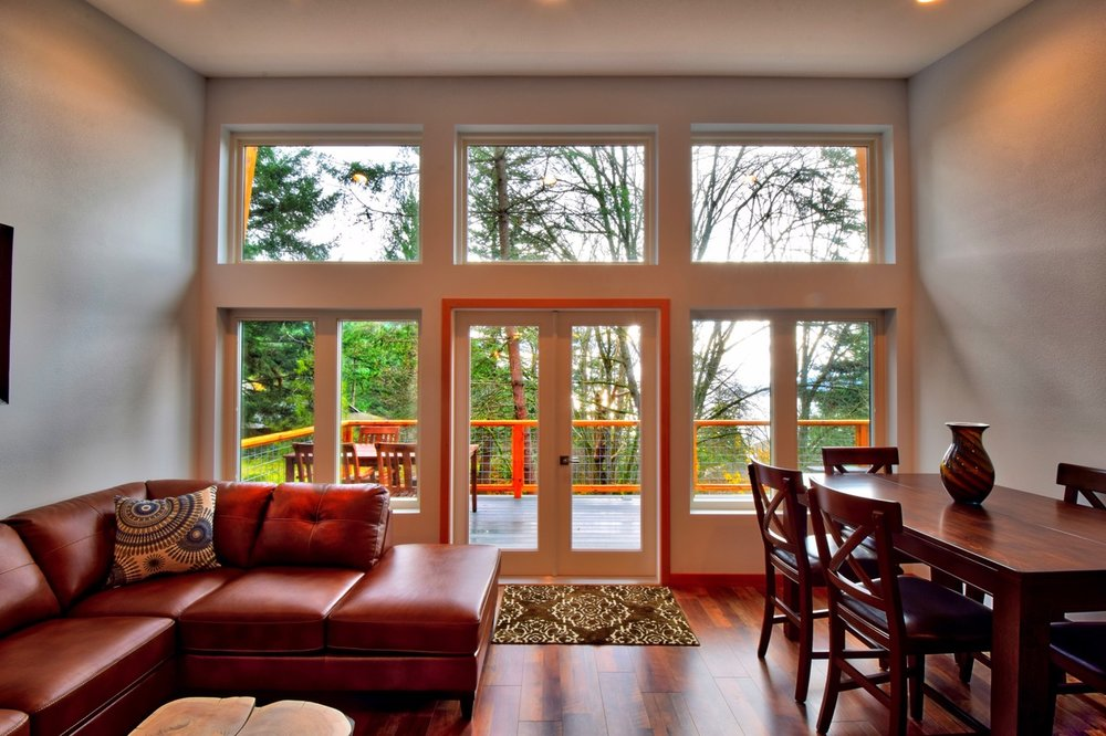 Vaulted ceilings from kitchen to living reach nearly 12-feet along the wall of windows.