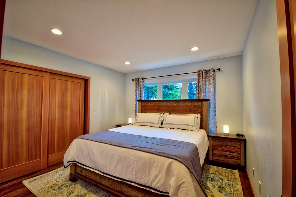 The second guest bedroom also features a king-sized bed and is located across the hall from the guest bathroom.