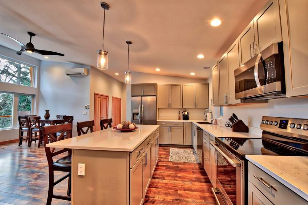 Spacious kitchen that's open to the living and dining area, featuring quartz counters, stainless appliances and all the items to prepare gourmet meals in the home.
