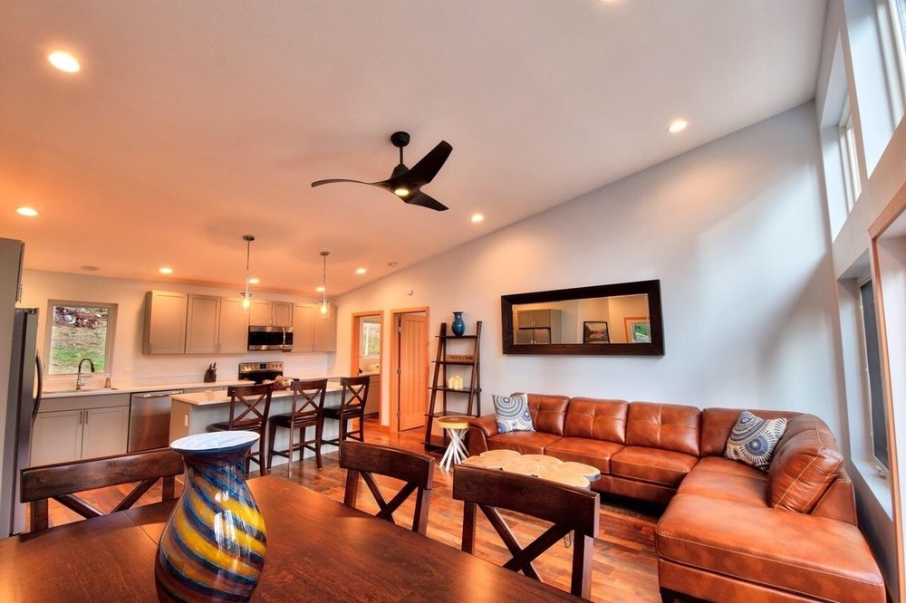 A large, comfortable sectional sofa provides a relaxing atmosphere for guests to gather.