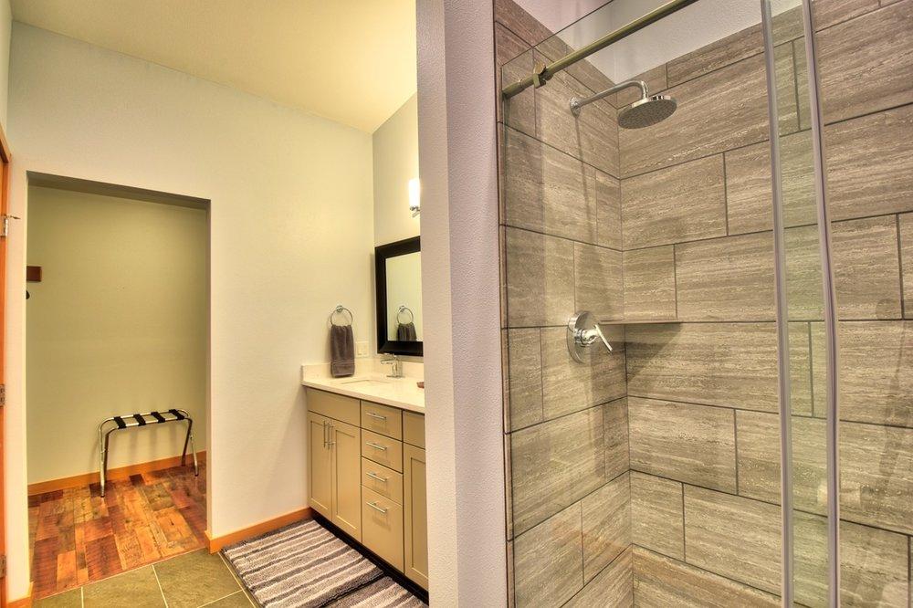 The en suite master bathroom also features a walk-in closet.