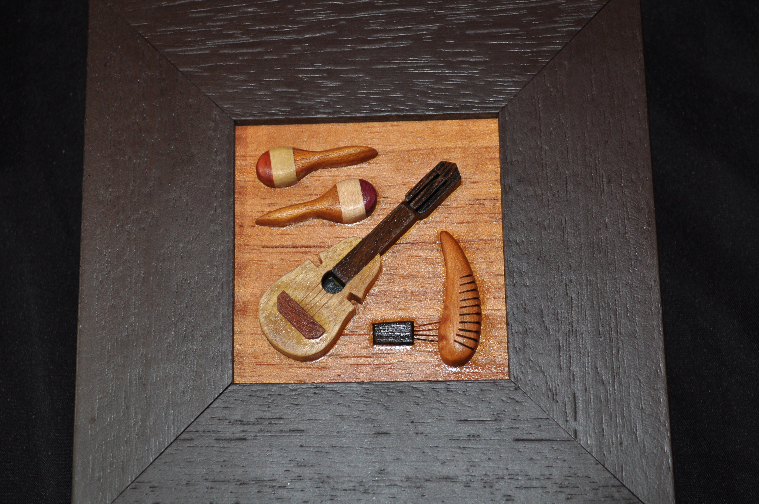 Puerto Rican musical instruments made with the intarsia technique. Photo: Pamy Rojas
