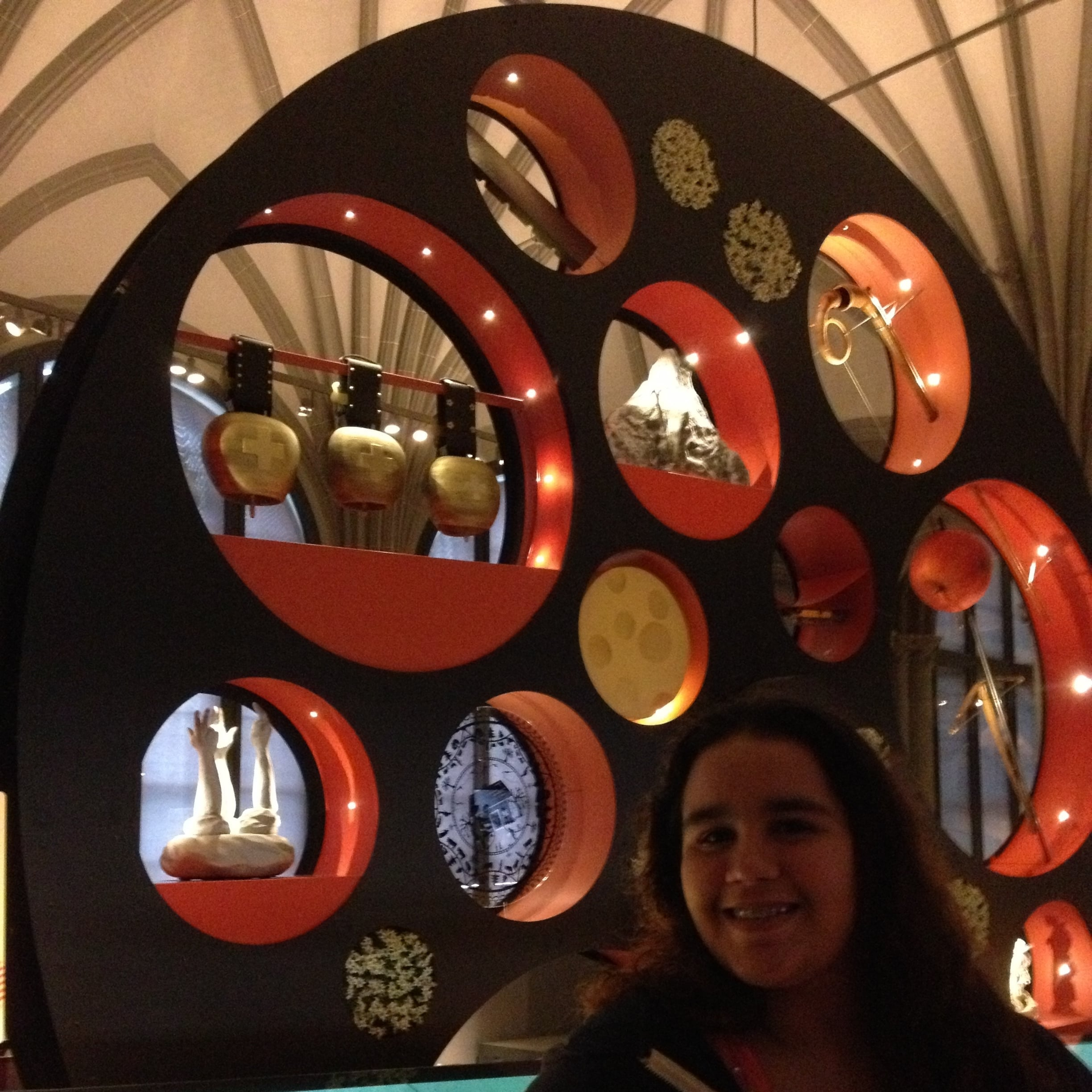 This wheel with images of Heidi, William Tell, cowbells and cheeses is an installation in the Swiss history area at the National Museum. Photo: Bruny Nieves