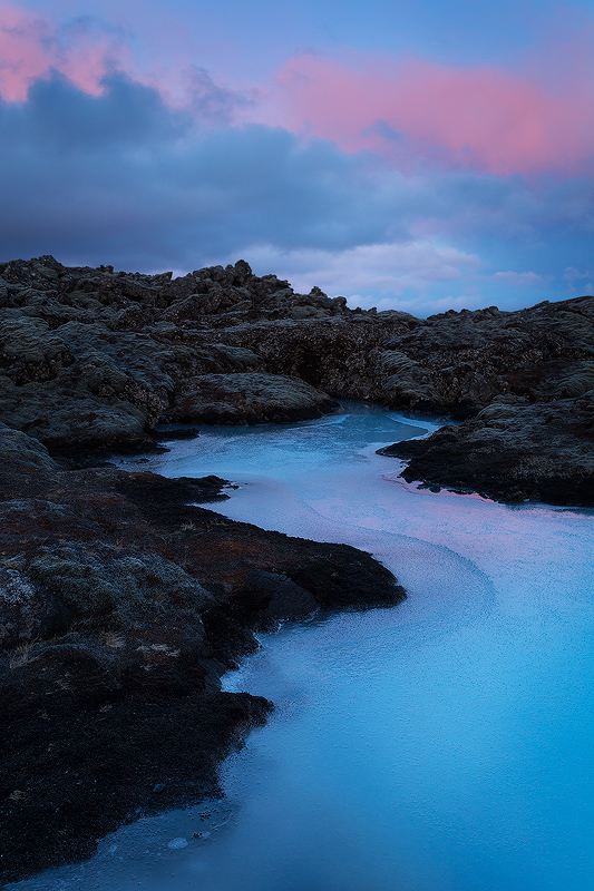Blue Lagoon, Iceland.  This water is geothermally heated, so the fact that it is frozen gives a queue as to how cold it was on that particular morning.  Good clothing choices allowed me to stay outside for this loooong winter sunrise even though it was ridiculously cold.