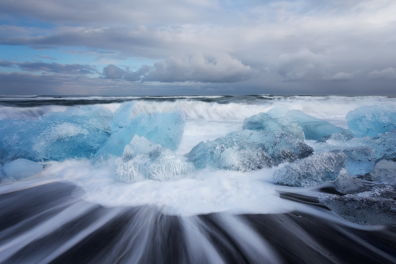 Waves and Ice at Jökulsárlón's black sand beach, southern Iceland