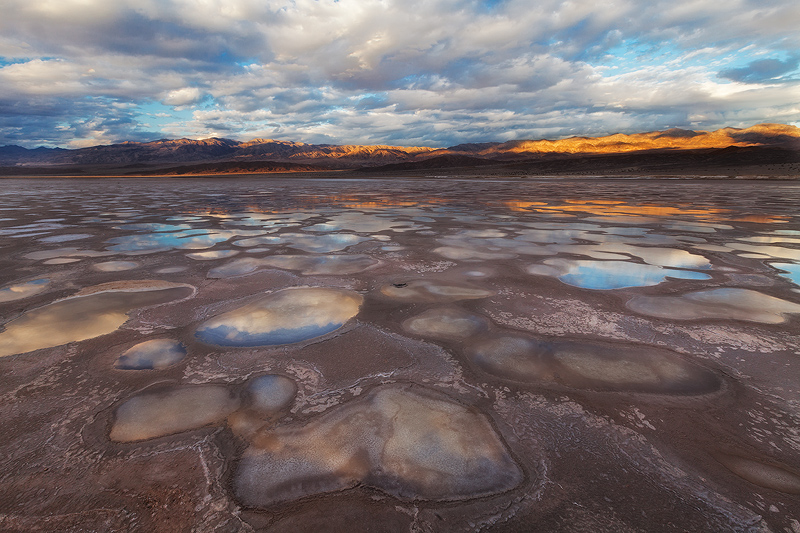 Small pools of water on a mud flat in Death Valley National Park