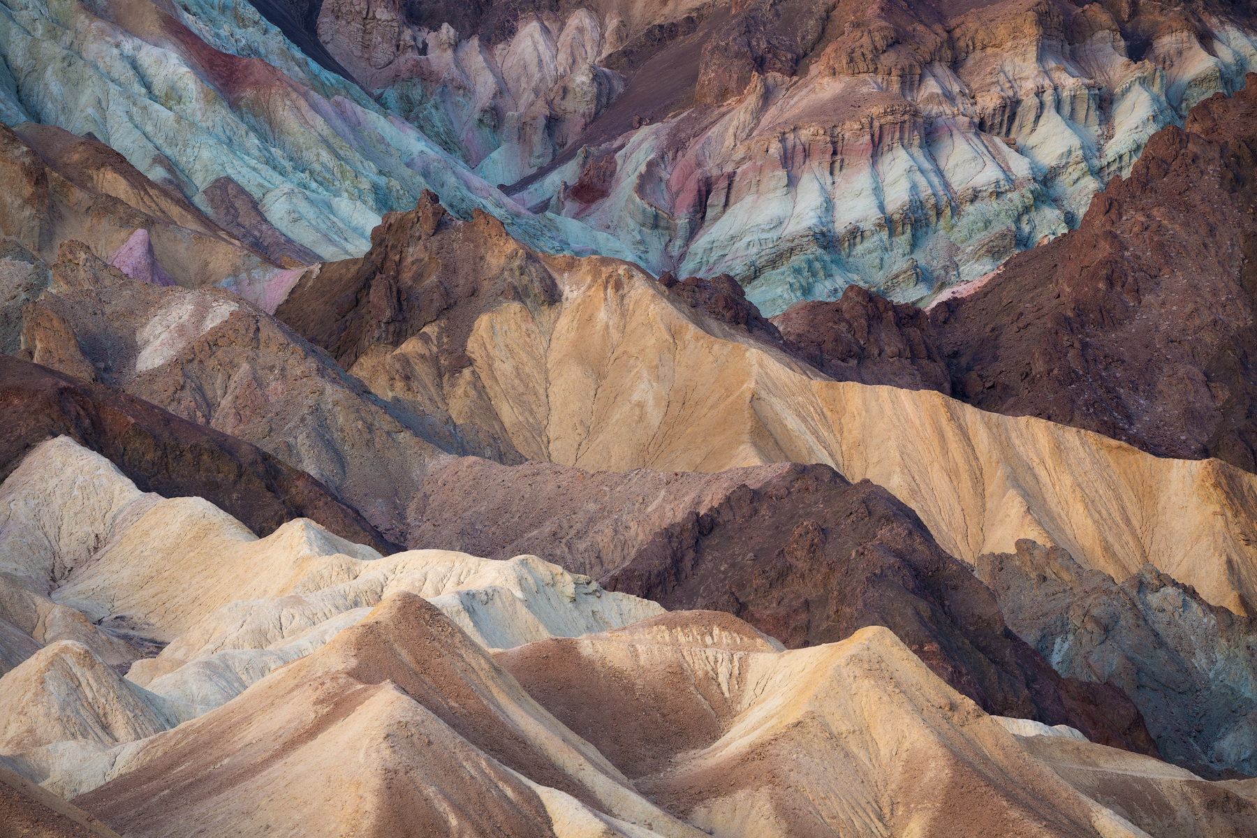 Colorful badlands, Death Valley National Park. For this spot, we saved the parking area in our car GPS and then specific vantage points that require hiking to access in our Gaia app. This makes navigating to the right spot at sunrise quite easy.
