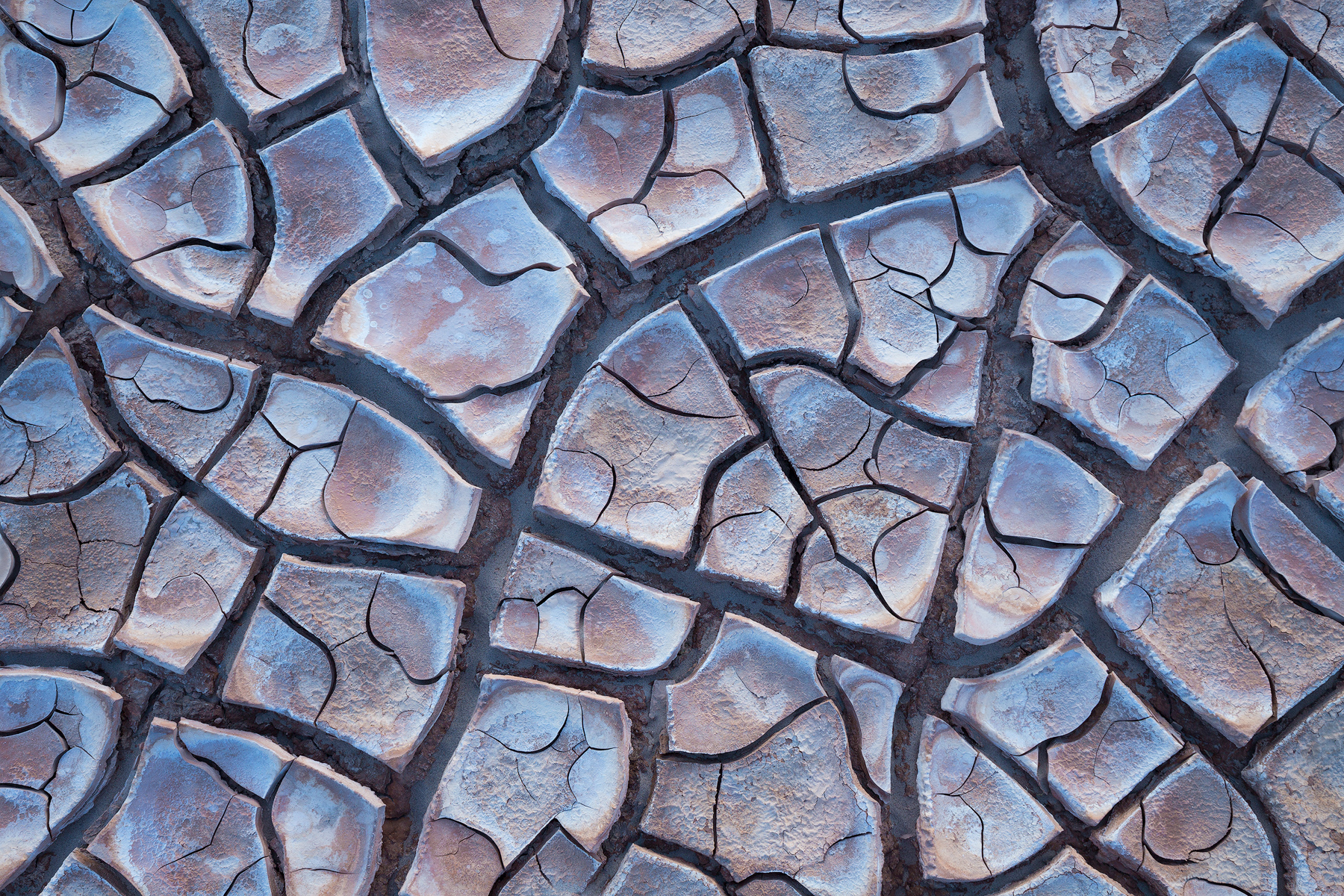 Cracked mud, Death Valley National Park. This small patch of cracked mud is located in a very expansive area with few navigational aids. Saving the GPS coordinates for this spot as a Gaia waypoint, along with a photo, makes returning to this exact location easy.