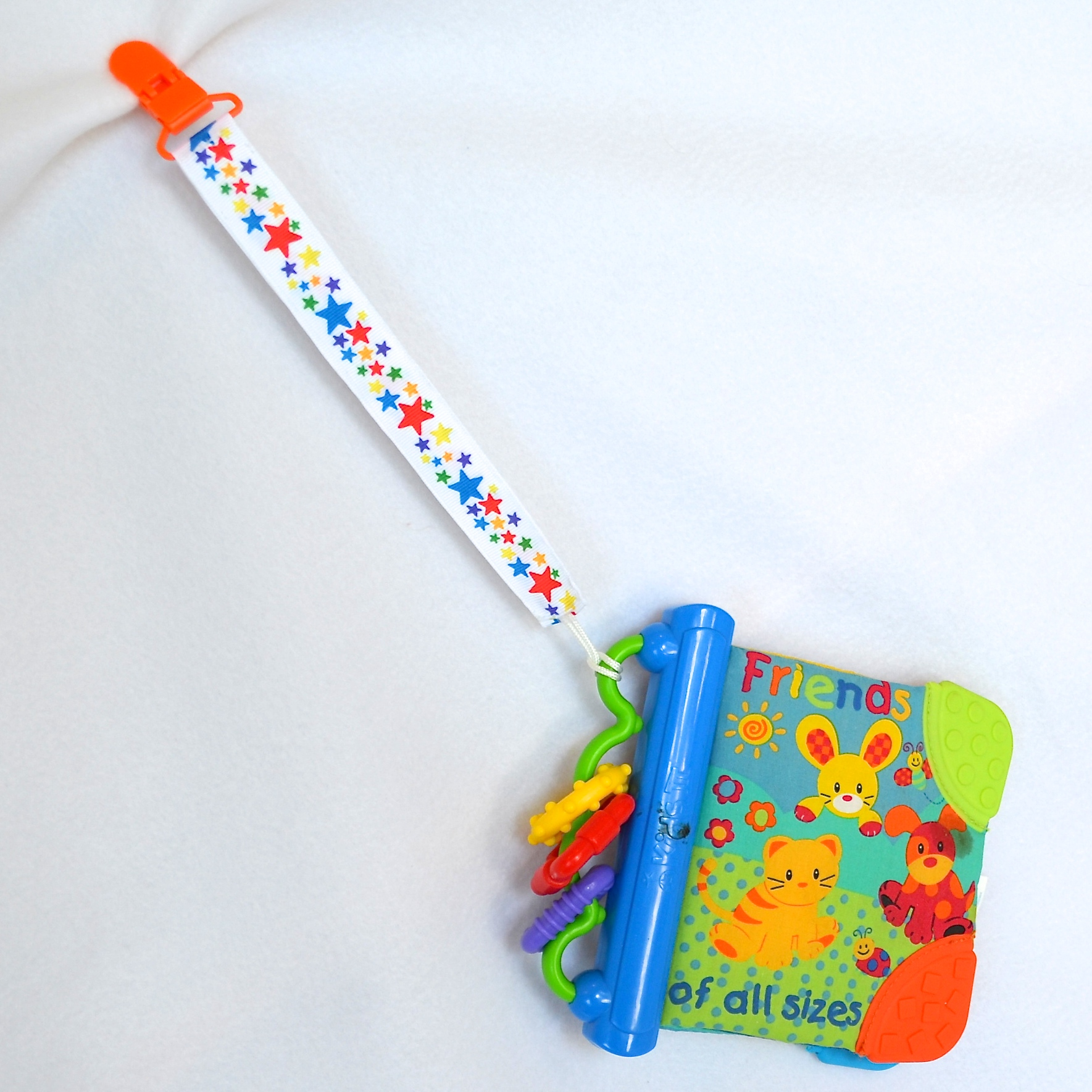 Pacifier-Clip-Holding-Book.JPG