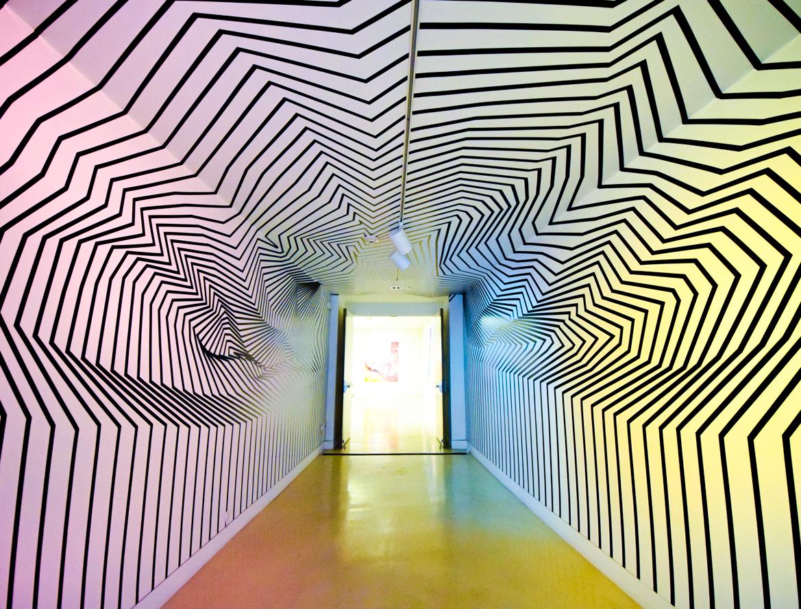 TAM documentation-tape-installation-dimensionalizing-the-hall-3.jpg