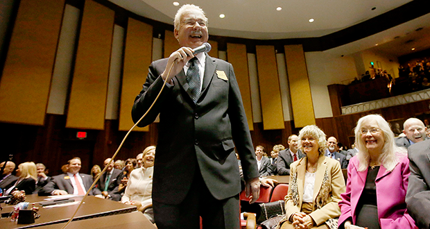 Rep. John Kavanagh, R-Fountain Hills, smiles as he addresses the legislature in the Arizona House of Representatives at the Arizona Capitol Monday, Jan. 13, 2014, in Phoenix. The Republican lawmaker wants the state constitution amended to allow cuts to public employee pensions and increases in employee contributions if the systems are badly underfunded. (AP Photo/Ross D. Franklin)