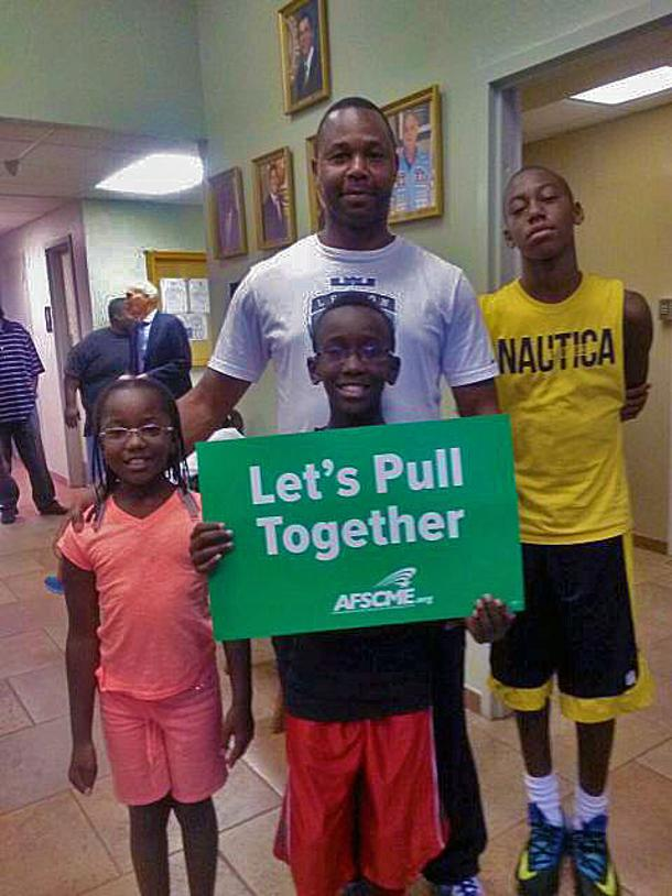 AFSCME Local 3294 member Randolph Brown and his family attended the Commission meeting.