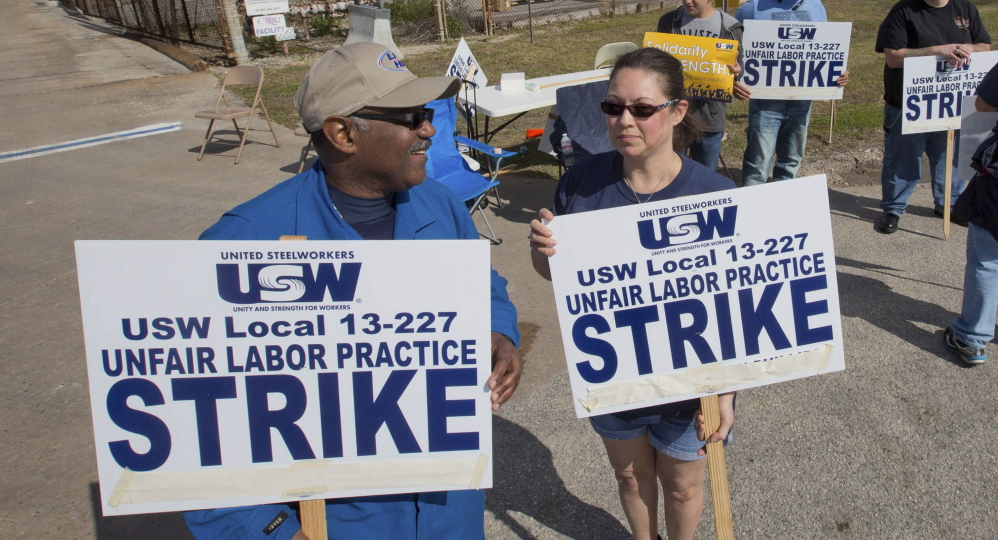 Workers from the United Steelworkers picket outside the Lyondell-Basell refinery in Houston.  Reuters