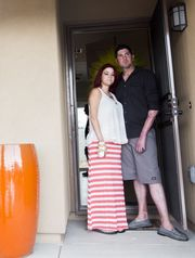 Tiara Del Rio and Beau Zimbro pose for photos at their new home in Peoria, AZ on May 15, 2015. Del Rio and Zimbro lost their home in an explosion in 2013. Local Peoria organizations are teaming up to host a house warming party to thank all the businesses that have donated to the home construction and fundraise for furniture and home goods.  (Photo: Patrick Breen/The Republic/azc)