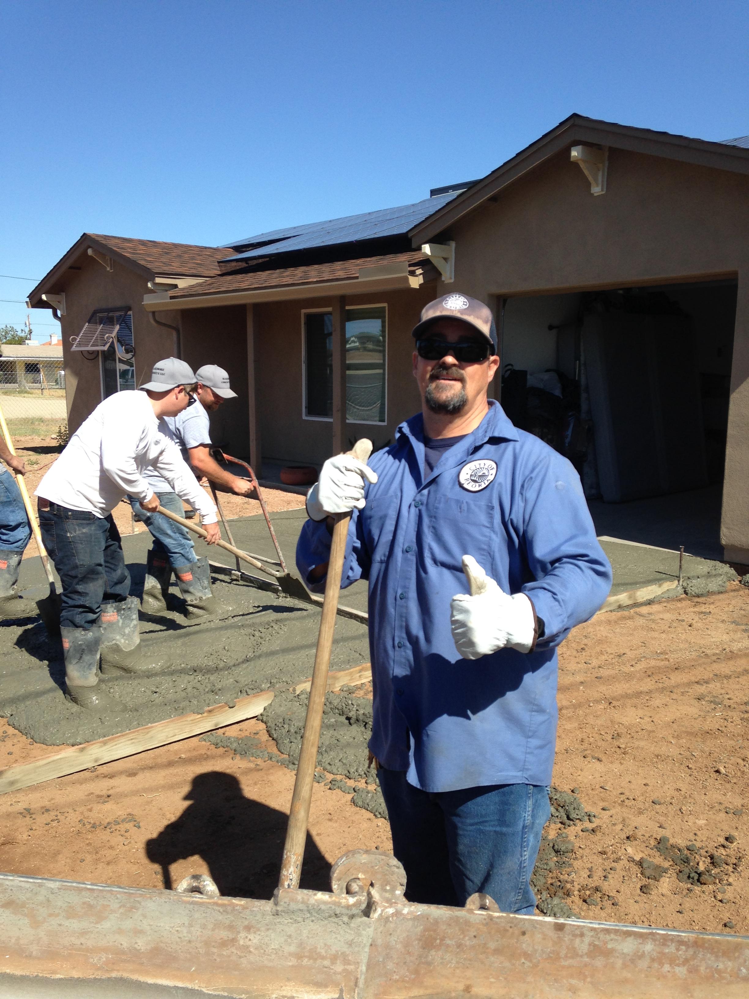05.09.15_12 Concrete pour_Tom Davis and volunteers.jpg