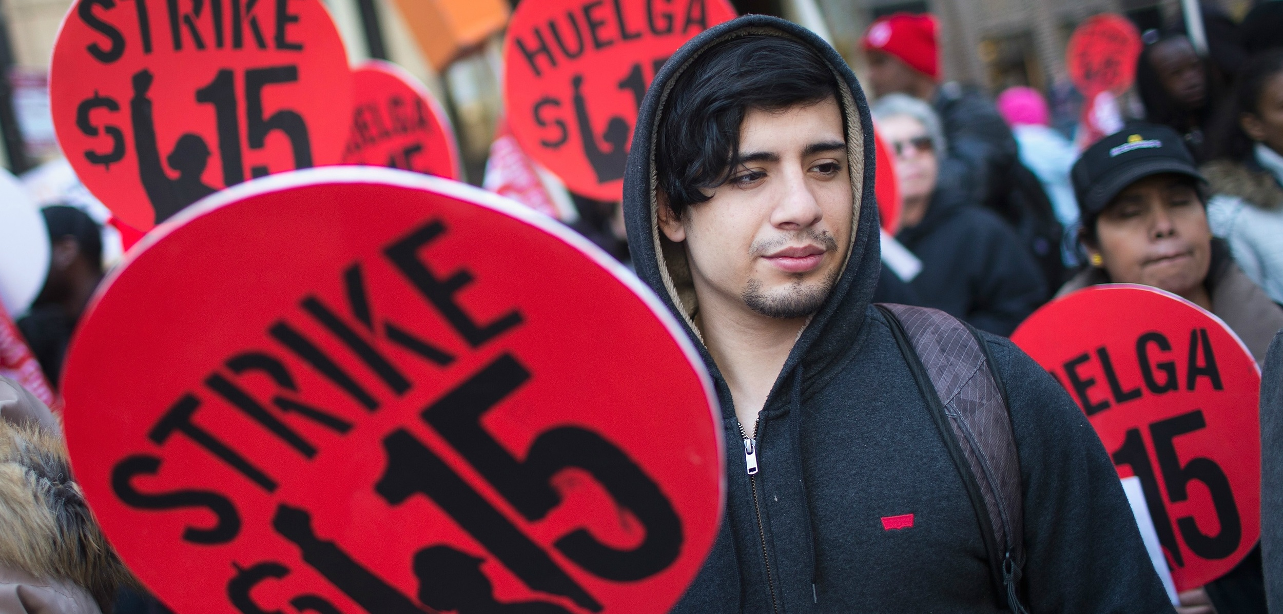 Demonstrators demand an increase in the minimum wage to $15 per hour in Chicago on April 14.  Photo credit: SCOTT OLSON/Getty Images