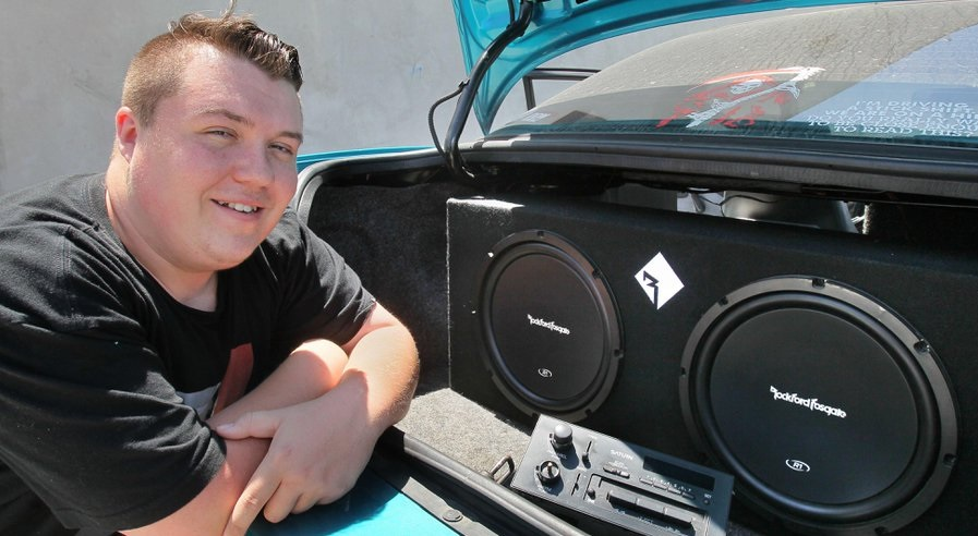 June 2, 2016, Vista, California, USA_| Billy May-Hatch shows off the high end stereo speakers he installed in his car that's parked at North County Tech High School in a small Vista industrial complex. He graduates this week and earned a pre-apprentice diploma that allows him to get an apprenticeship in the electrical business. | Mandatory Photo Credit: Photo by Charlie Neuman/San Diego Union-Tribune/©2016 San Diego Union-Tribune, LLC   San Diego Union-Tribune