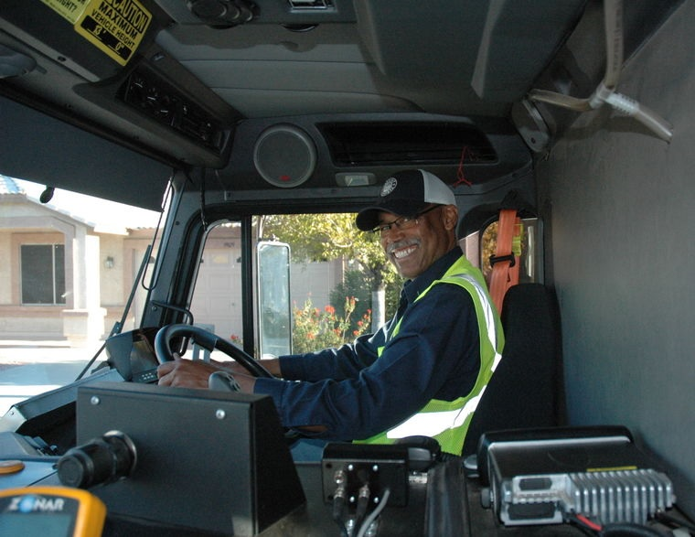 """Photo by Leslie McMorrow  Willie """"The Wizard"""" Townsend, behind the wheel, with his trademark smile."""