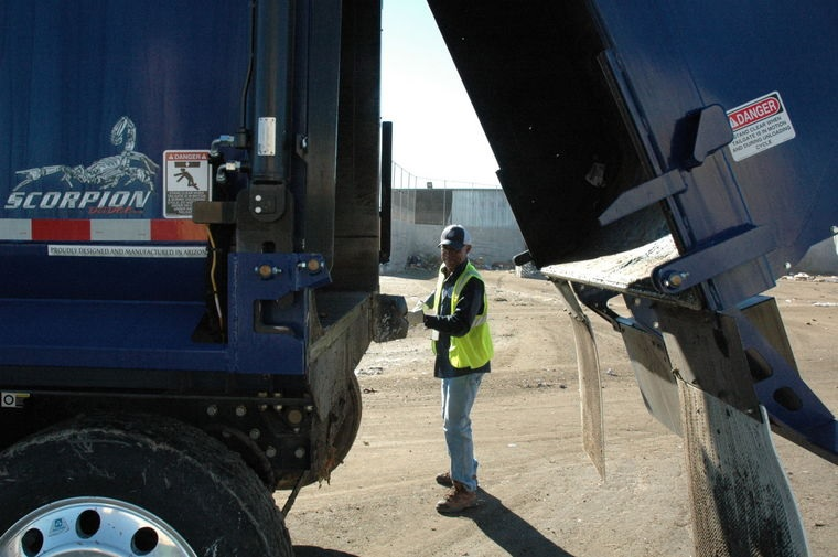 Photo by Leslie McMorrow  As part of their safety checks, Peoria sanitation drivers are tasked with cleaning the seals of their trucks after each dump, to help reduce possible leaks.