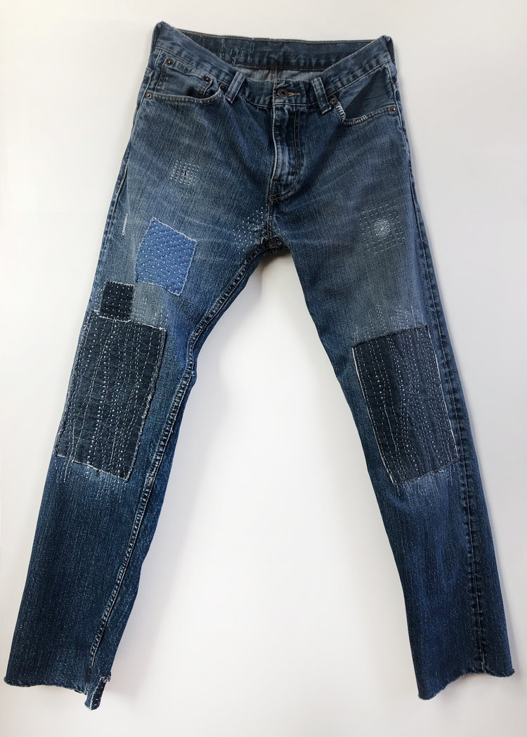 Katherine Allred    Repaired Jeans   Levi 521 jeans, cotton thread, cotton fabric scraps  48 x 24 in.
