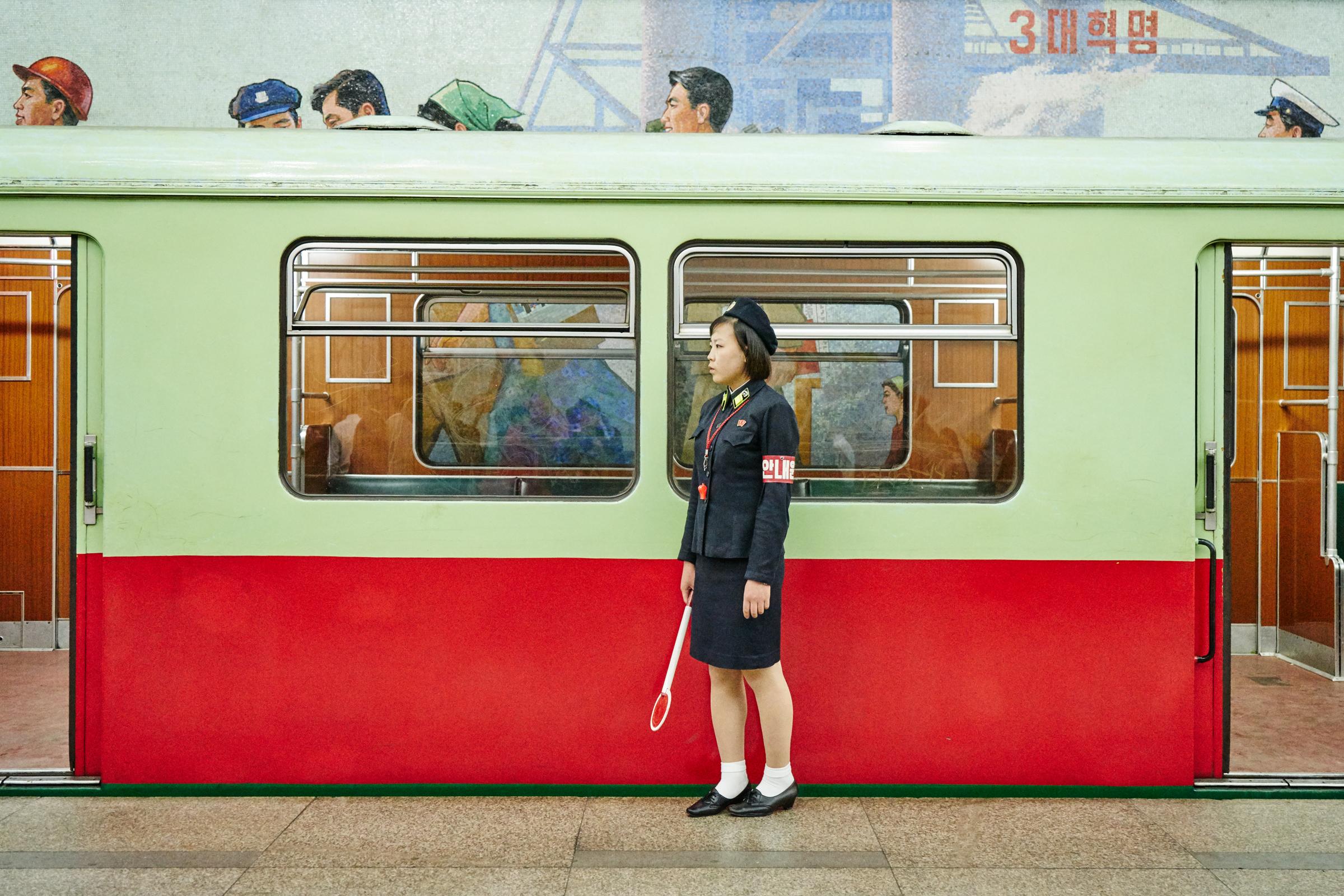 Train conductor, Pyongyang metro station.