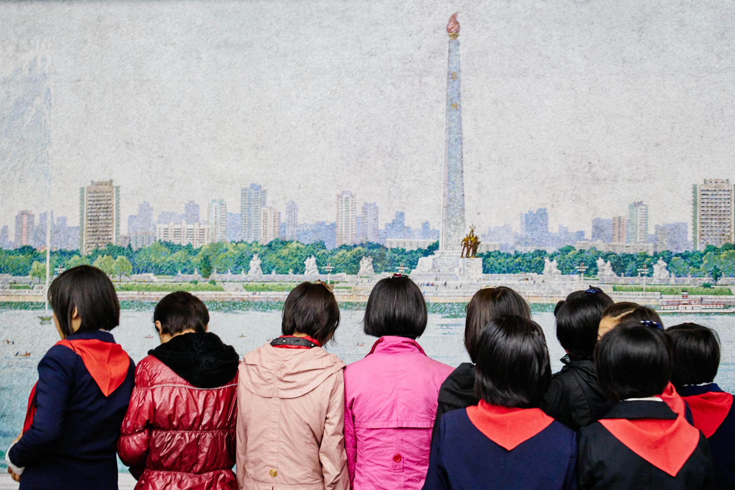 School children wait for the train inside Pyongyang metro station.