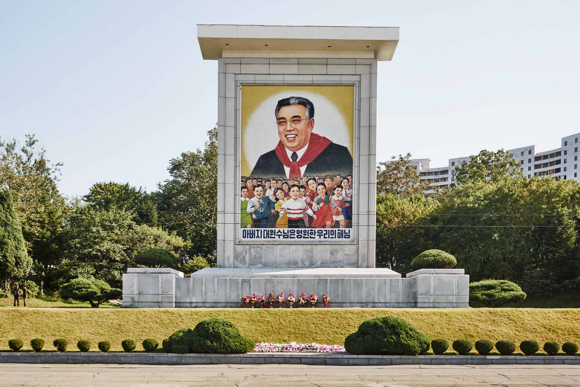 Passing by one of the many Propaganda art across the country. Pyoungyang, NK