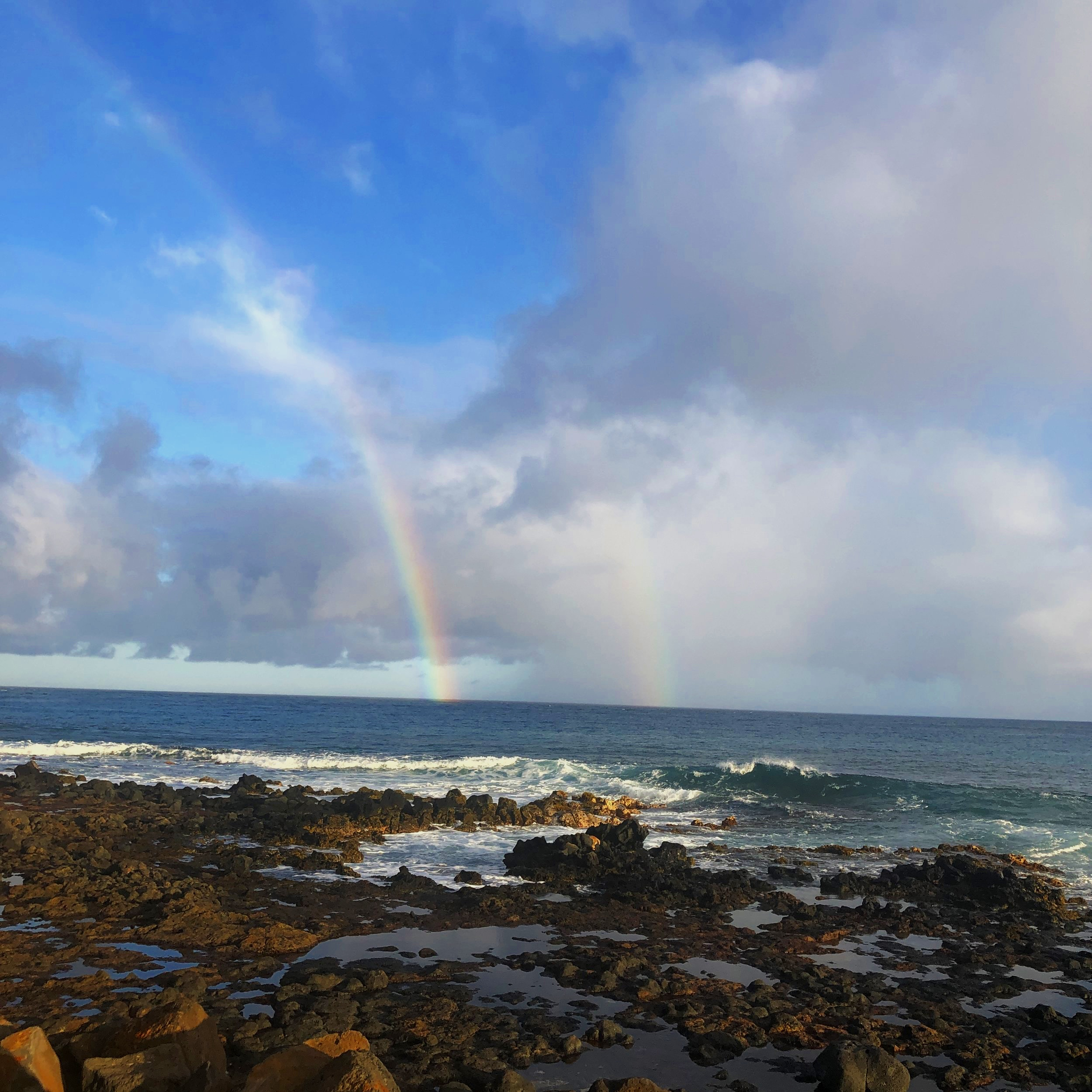 A double rainbow over the South Pacific at Poipu Beach Park